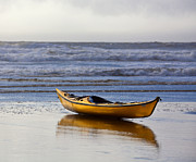 Relaxed Photo Framed Prints - Kayak Resting on an Ocean Shore Framed Print by David Buffington