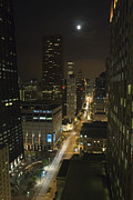 Shining Down Prints - Looking south on North Michigan Avenue in Chicago down on traffic on a moonlight night Print by Purcell Pictures