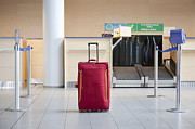 Airport Concourse Prints - Luggage at an Airline Check-In Counter Print by Jaak Nilson
