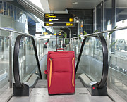 Escalator Prints - Luggage at the Top of an Escalator Print by Jaak Nilson