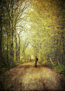 Fall Grass Prints - Man walking  on a lonely country road Print by Sandra Cunningham