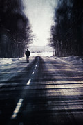 Gritty Framed Prints - Man walking on a rural winter road Framed Print by Sandra Cunningham