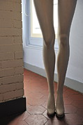 Tiled Posters - Mannequin legs standing by window Poster by Sami Sarkis