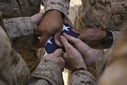 Commemorating Prints - Marines Fold An American Flag Print by Stocktrek Images