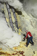Craters Prints - Miner Breaking Up Sulphur Deposits Print by Richard Roscoe