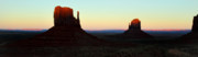 Monument Valley Photos - Mittens at sunset in Monument Valley by Pierre Leclerc