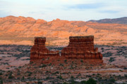 Monument Prints - Monument at sunset in Arches National Park Print by Pierre Leclerc