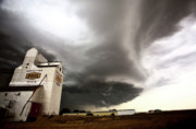 Nasty Prints - Nasty looking cumulonimbus cloud behind grain elevator Print by Mark Duffy