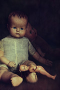 Doll Photos - Old dolls sitting on wooden table by Sandra Cunningham