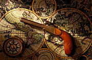 Compasses Prints - Old gun on old map Print by Garry Gay