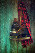 Antique Skates Posters - Old ice skates hanging on barn wall Poster by Sandra Cunningham
