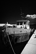 Municipality Prints - Old Metal Tug Boat In The Harbour In Latchi Village In The Polis Municipality Republic Of Cyprus  Print by Joe Fox