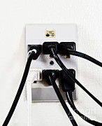 Electrical Plug Prints - Overloaded Outlet Print by Photo Researchers