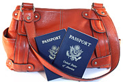 Handbag Posters - Passports with orange purse Poster by Blink Images
