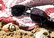 Beach Towel Photo Prints - Photochromatic Sunglasses Print by Martyn F. Chillmaid
