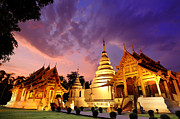 Valuable Framed Prints - Phra Singh temple twilight time Framed Print by Panupong Roopyai