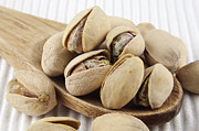 Salted Framed Prints - Pistachios on spoon Framed Print by Blink Images