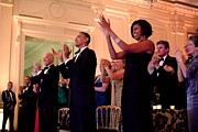 Dresses Photo Prints - President And Michelle Obama Applaud Print by Everett