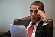 West Wing Prints - President Barack Obama Reads A Document Print by Everett