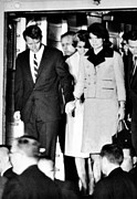 Bobby Kennedy Prints - President John Kennedys Body Arrives Print by Everett