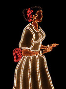 Arecibo Prints - Puerto Rico Woman in Lights Print by Carlos Reyes