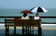 Umbrellas Digital Art - Rainy Day on the Boardwalk by William Kuta