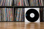 Hardwood Floor Prints - Records Leaning Against Shelves Print by Halfdark