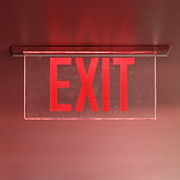 Exit Sign Prints - Red Exit Sign on Ceiling Print by Jeremy Woodhouse
