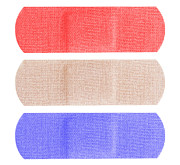 Treatment Posters - Red white and blue bandaids Poster by Blink Images