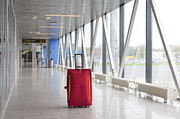 Airport Concourse Posters - Rolling Luggage in an Airport Concourse Poster by Jaak Nilson