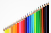 Colored Pencil Photos - Row of colorful crayons by Sami Sarkis