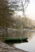 Small Boats Prints - Rowboat Sitting At The Shore Of A Lake Print by John Short