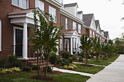 Front Porch Prints - Rows Of New Townhomes Print by Roberto Westbrook