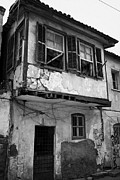 Decaying Prints - run down building with bay window in the old town of nicosia TRNC turkish republic northern cyprus Print by Joe Fox
