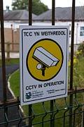 Big Brother Posters - Security Camera Sign At A School In Wales Poster by Mark Williamson