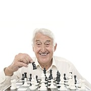 Chess Piece Posters - Senior Man Playing Chess Poster by