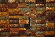 License Plates Prints - Side Of A Building Adorned With Old Print by Raymond Gehman