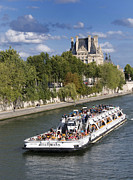 Tourists Posters - Sightseeing boat on river Seine to Louvre museum. Paris Poster by Bernard Jaubert