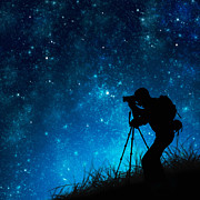Dark Background Prints - Silhouette Of Photographer Shooting Stars Print by Setsiri Silapasuwanchai