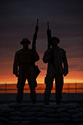 Firearms Photo Posters - Silhouette Of U.s Marines On A Bunker Poster by Terry Moore