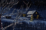 Illuminated Framed Prints - Snowy winter scene of a cabin in distance  Framed Print by Sandra Cunningham