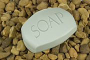 Sanitary Posters - Soap Bar on stones background Poster by Blink Images