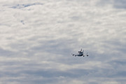 Washington D.c. Originals - Space shuttle Discovery Flyover over the Washington D.C. area  by Dasha Rosato