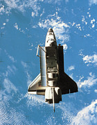 Space Shuttle Photo Prints - Space Shuttle Orbiting Above Earth Print by Stockbyte