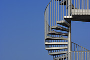 Spiral Staircase Photos - Spiral Staircase Against A Blue Sky by Martin Ruegner