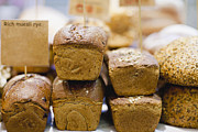 Loaf Of Bread Photo Prints - Stacks Of Fresh Bread For Sale Print by Hybrid Images