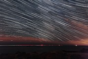 Startrails Photo Acrylic Prints - Star Trails Acrylic Print by Laurent Laveder