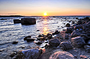 Cobble Stones Posters - Sunset over water Poster by Elena Elisseeva