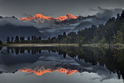 Snow-covered Landscape Photo Prints - Sunset Reflection Of Lake Matheson Print by Colin Monteath