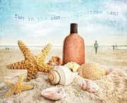 Suntan Prints - Suntan lotion and seashells on the beach Print by Sandra Cunningham